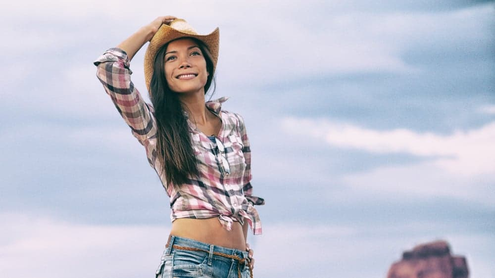 Cowgirl standing outdoors